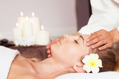 Face Massage. Close-up of a beautiful Woman Getting Spa Treatmen stock photography