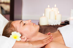 Face Massage. Close-up of a beautiful Woman Getting Spa Treatmen Stock Photo