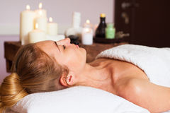 Face Massage. Close-up of a beautiful Woman Getting Spa Treatment. stock photo