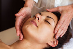 Face Massage. Close-up of a beautiful Woman Getting Spa Treatmen Royalty Free Stock Images
