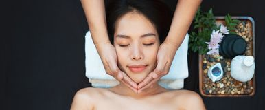 Face massage. Close-up of young woman getting spa massage treatment at beauty spa salon. Spa skin and body care. Facial beauty stock images