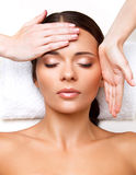 Face Massage. Close-up of a Young Woman Getting Spa Treatment. Royalty Free Stock Images