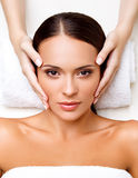 Face Massage. Close-up of a Young Woman Getting Spa Treatment. Stock Photography