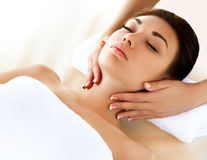 Face Massage. Close-up of a Young Woman Getting Spa Treatment. Royalty Free Stock Photo
