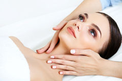 Face Massage. Close-up of a Young Woman Getting Spa Treatment. Royalty Free Stock Image