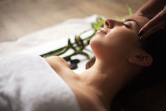 Face Massage. Close-up of a Young Woman Getting Spa Treatment. Royalty Free Stock Photos