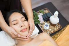 Face massage. Close-up of young woman getting spa massage treatment at beauty spa salon. Spa skin and body care. Facial beauty stock photography