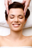 Face Massage. Close-up of a Young Woman Getting Spa Treatment. H Royalty Free Stock Photo