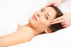 Face Massage. Close-up of a Young Woman Getting Spa Treatment. High quality image Royalty Free Stock Photography