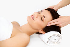 Face Massage. Close-up of a Young Woman Getting Treatment in Spa Stock Photos