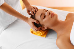 Face massage. Face treatment, skin care, wellbeing, wellness con Royalty Free Stock Image