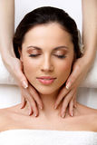 Face Massage.l Woman Getting Spa Treatment. Spa Woman. Close-up of a Beautiful Woman Getting Spa Treatment in Spa Salon. Face Massage Royalty Free Stock Photography