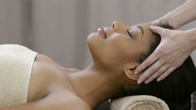 Face massage at spa stock video footage