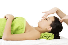 Face massage therapy at spa saloon. Beautiful young relaxed woman enjoy receiving face massage therapy at spa saloon Royalty Free Stock Image