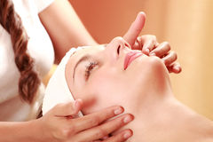 Face massage Stock Images