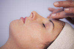 Face massage. Woman receiving face massage in spa Royalty Free Stock Photography