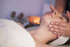 Face massage. Woman in spa receiving face massage Royalty Free Stock Photo