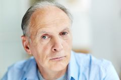 Calmness. Face of mature man looking at camera with calm expression Stock Image