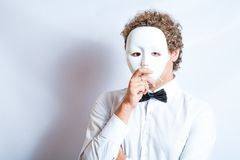 Face mime close-up emotion in thought, a black bow Royalty Free Stock Image