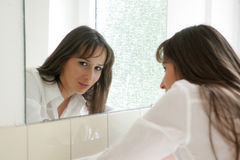 Face in Mirror. Beautiful Girl looking at mirror Stock Photography