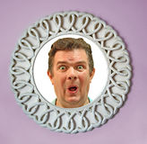 Face in mirror Stock Image