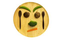 Face of Mix vegetables mushroom,carrot,broccoli,bean and wooden utensil Stock Photo