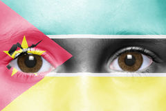 Face with mozambican flag Stock Photography