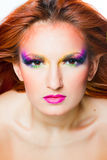 Face with multicolored make-up Stock Photo