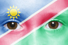 Face with namibian flag. Human`s face with namibian flag Royalty Free Stock Image