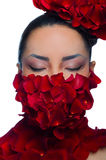 Face and neck girl covered with petals Royalty Free Stock Images