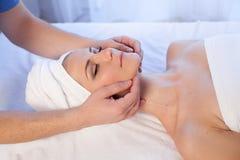 Face and neck massage beautiful woman at Spa stock photo
