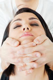Face neck thai massage. Close-up of young woman's face, receiving traditional thai neck massage royalty free stock photos