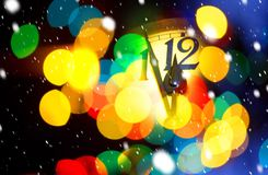Face of new year clock. With colored decoration royalty free stock photos