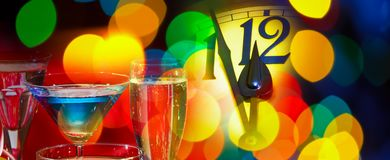 Face of new year clock. With glasses of wine royalty free stock photo