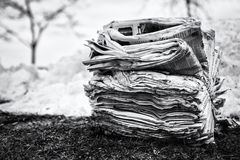 Face news. TORONTO, CANADA - JANUARY 15, 2017 - A bundle of newspapers in the outdoors during winter Stock Images