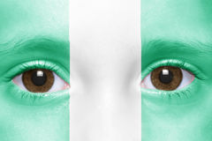 Face with nigerian flag Royalty Free Stock Photography