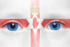 Face with northern ireland flag. Human`s face with northern ireland flag royalty free stock image