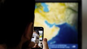 Face obstructed face id anonymous hacker. PARIS, FRANCE - CIRCA 2017: Face Obstructed message on display of new Apple iPhone X with Face ID virtual facial stock video footage