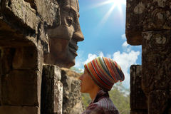 Face Of Woman On The Background Of The Stone Head Stock Photography