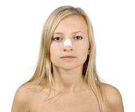 Face Of Young Woman With Sticking Plaster On Nose Royalty Free Stock Photography