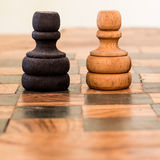 Face off. Two pawns wooden clash, one black, one white Stock Photos