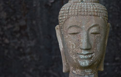 Face of old imgae of buddha statue Thailand temple Stock Images