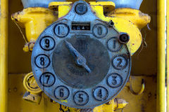 Face of old petrol pump. Dial on face of very old petrol or diesel pump on farm, South Africa Royalty Free Stock Image