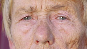 Face of old woman stock footage