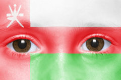 Face with omani flag Stock Image