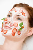 Face pack. Girl with fruit and cream Stock Images