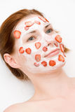 Face pack. Girl with friut and cream Stock Photos