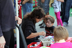 Face Paint. A boy gets his face painted at Fan Fest in Austin, Texas for the formula one Royalty Free Stock Image