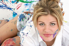 Face Paint. Beautiful young woman in white shirt covered in paint royalty free stock photography