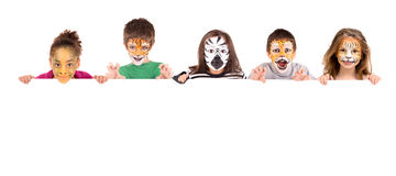 Face-paint. Children's group with face-paint over a white board Stock Photography